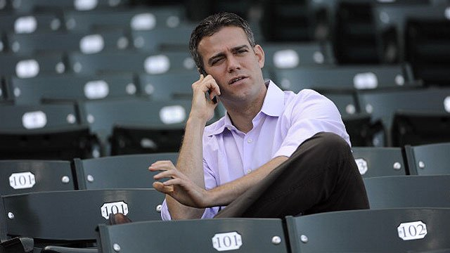 President of Baseball Operations Theo Epstein of the Chicago Cubs watches batting practice before a game against the San Diego Padres on May 1, 2013 at Wrigley Field in Chicago, Illinois. (Photo by David Banks/Getty Images)