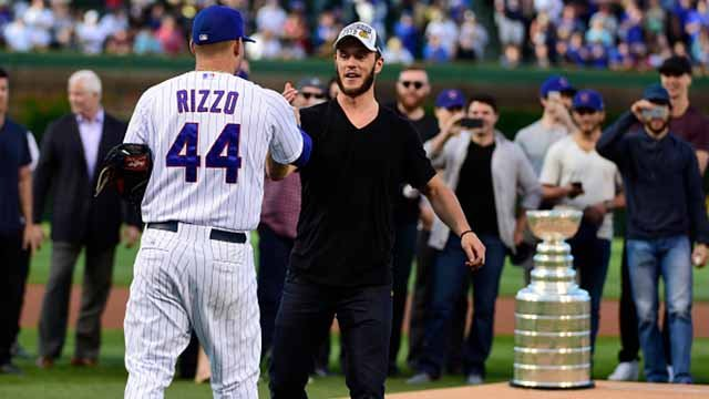 Chicago Blackhawks Jonathan Towes is greeted by Anthony Rizzo #44 of the Chicago Cubs after throwing out the ceremonial first pitch with his teammates before the game between the Chicago Cubs and the Cleveland Indians on June 16, 2015 at Wrigley Field
