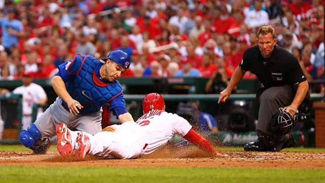 JUNE 26: Randal Grichuk #15 of the St. Louis Cardinals is tagged out at home by Miguel Montero #47 of the Chicago Cubs in the second inning at Busch Stadium on June 26, 2015 in St. Louis, Missouri