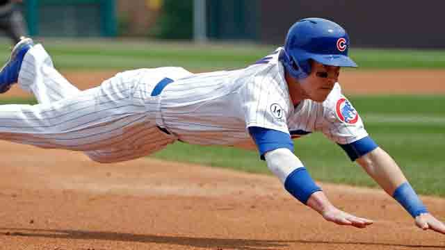 CHICAGO, IL - JULY 05: Chris Coghlan #8 of the Chicago Cubs dives into third base on a single by Kris Bryant #17 (not pictured) against the Miami Marlins during the first inning at Wrigley Field on July 5, 2015 in Chicago, Illinois. (Photo by Jon Durr/Get