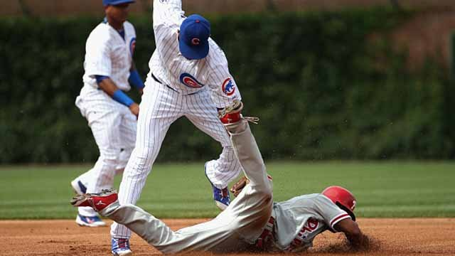 Ben Revere #2 of the Philadelphia Phillies steals second base in the 1st inning as Addison Russell #22 of the Chicago Cubs misses the ball at Wrigley Field on July 24, 2015 in Chicago, Illinois