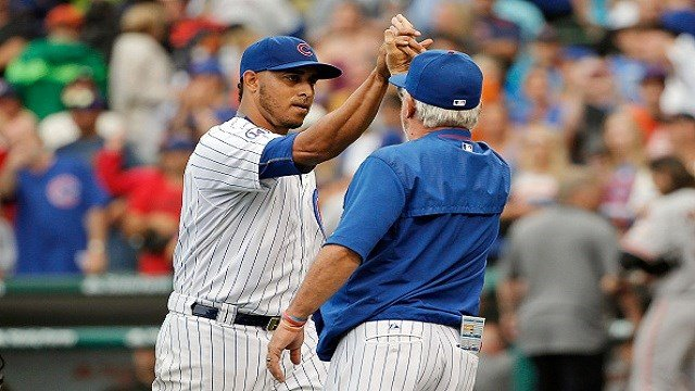 Hector Rondon #56 of the Chicago Cubs and manager Joe Maddon #70 high five after beating the San Francisco Giants at Wrigley Field on August 9, 2015 in Chicago, Illinois. The Chicago Cubs won 2-0. (Photo by Jon Durr/Getty Images)