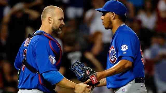 David Ross #3 of the Chicago Cubs (L) and Hector Rondon #56 shake hands after their win over the Chicago White Sox at U.S. Cellular Field on August 15, 2015 in Chicago, Illinois. The Chicago Cubs won 6-3.