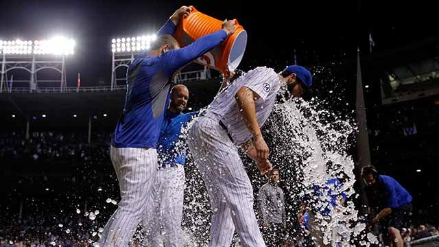 Jake Arrieta #49 of the Chicago Cubs is doused after his 20th win of the season against the Milwaukee Brewers at Wrigley Field on September 22, 2015 in Chicago, Illinois. The Chicago Cubs won 4-0.